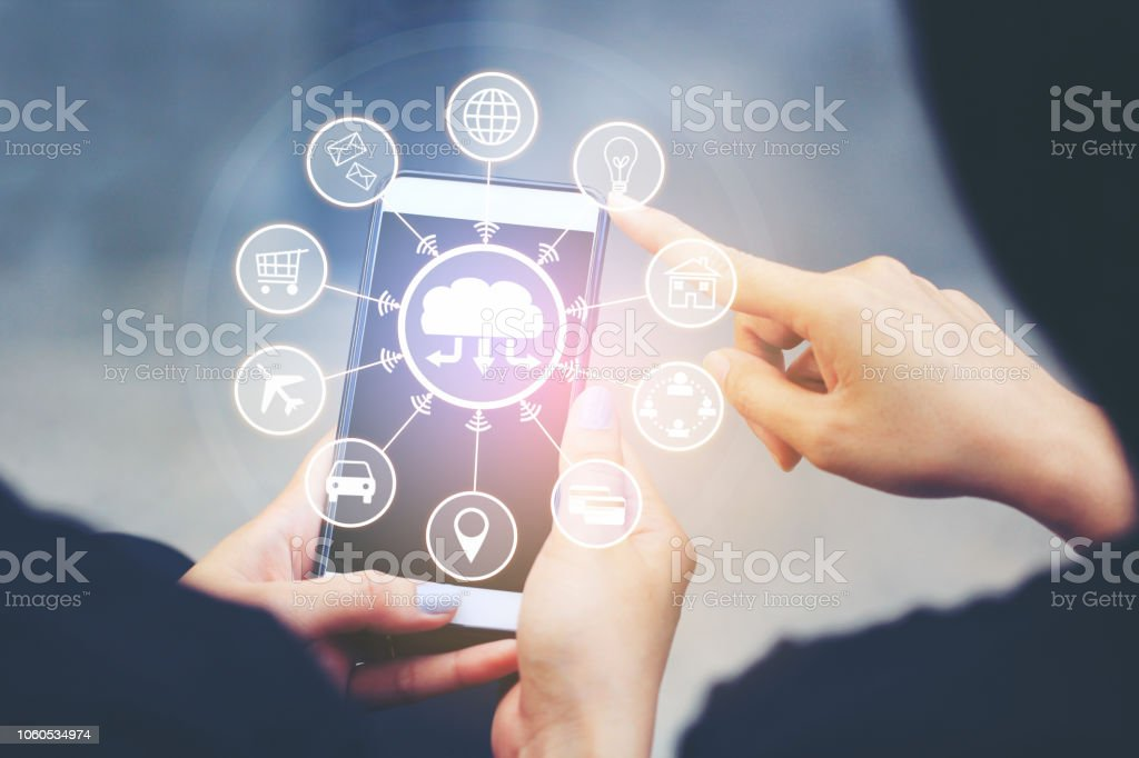 Internet of Things (IoT), Woman using smartphone and iot icon or hologram, Communication network service and Business concept stock photo