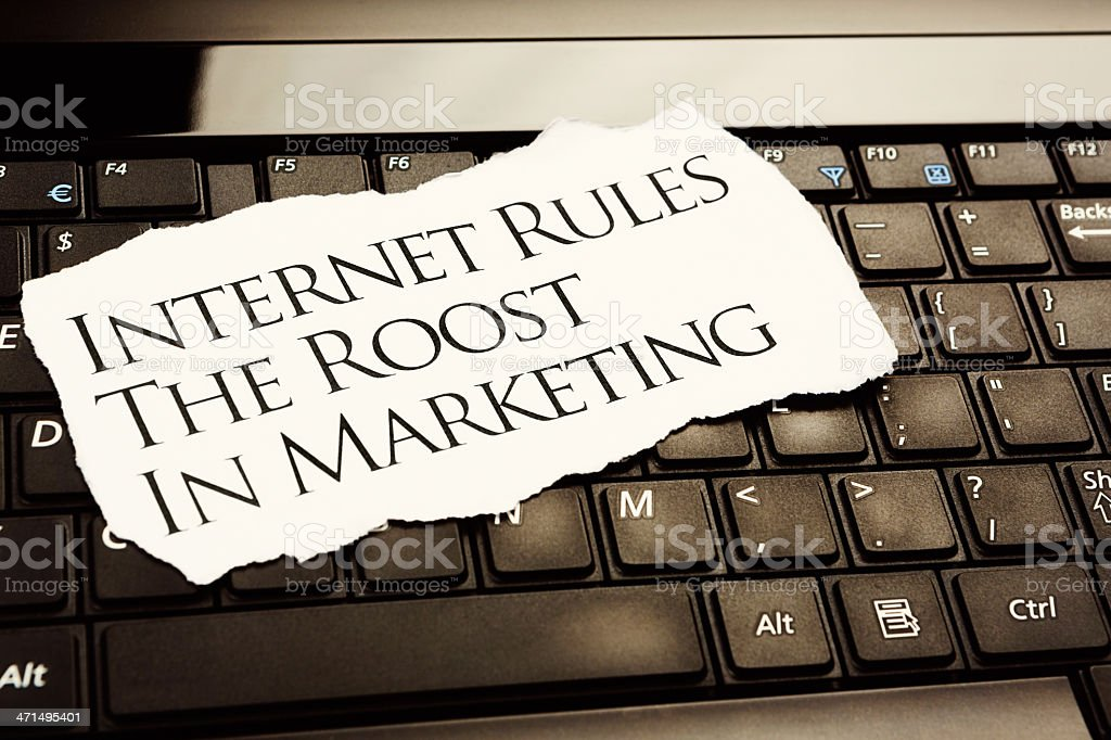 Internet rules the roost in marketing headline on computer keyboard stock photo