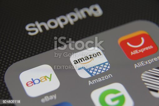 Berlin, Germany - 05 28 2016: Apple iPhone 6s screen with internet shopping e-commerce applications eBay, Amazon, AliExpress, Groupon, PayPal etc.