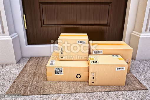 Cardboard boxes on the door mat near the entrance door
