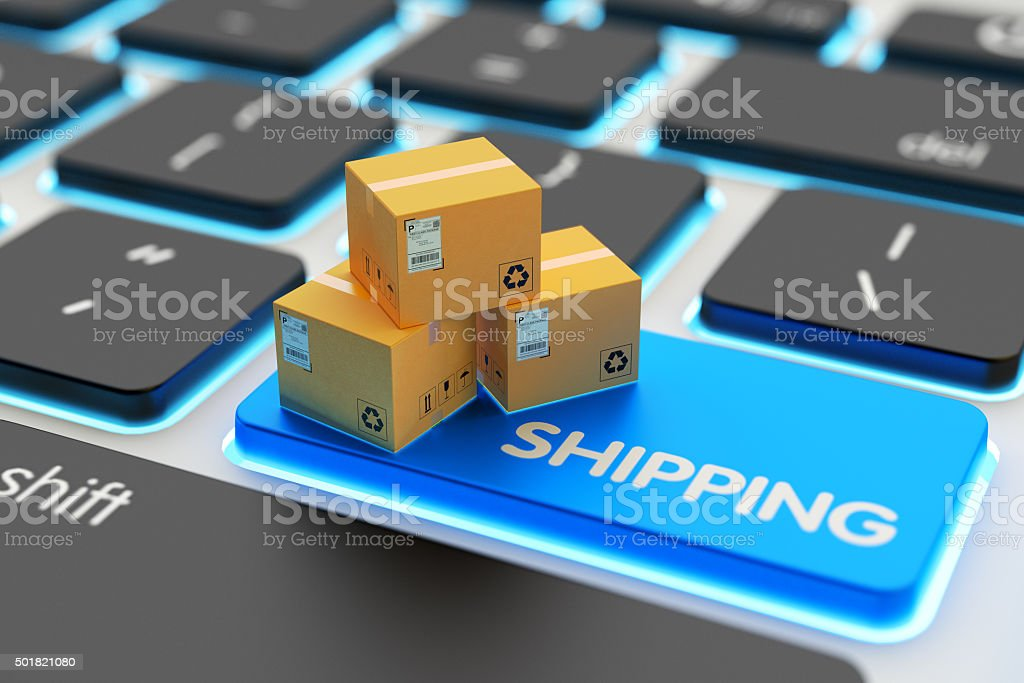 Internet shopping, online purchases, packages delivery and shipping service concept E-commerce, cardboard boxes on computer keyboard key closeup view 2015 Stock Photo