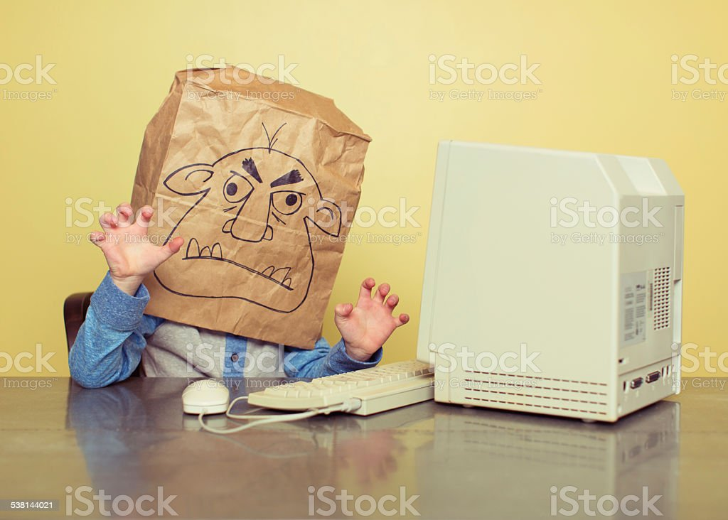 Internet Troll is Mean at the Computer stock photo