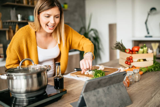 Internet tutorials for making lunch stock photo