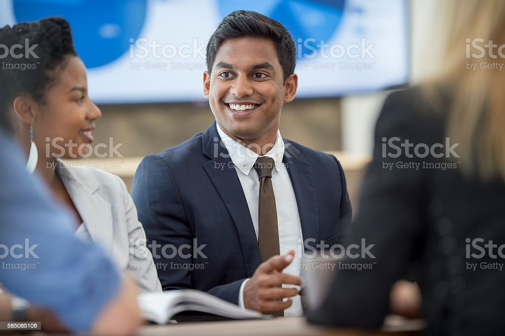 Interns Working on a Business Project stock photo