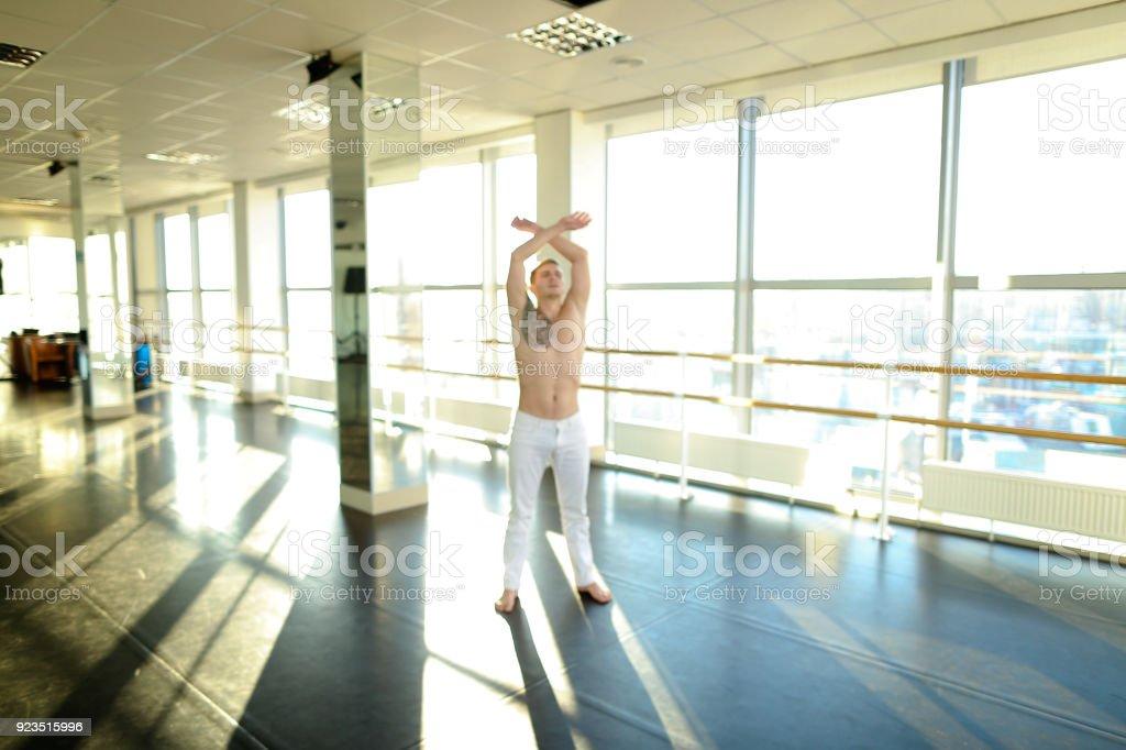 Interpreter in sportswear doing press exercises in sport hall stock photo