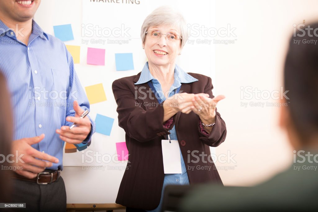 Interpreter signing during business meeting. stock photo