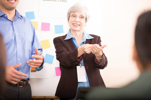 interpreter signing during business meeting. - sign language stock photos and pictures