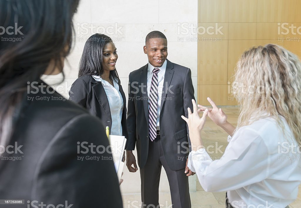 Interpreter signing to young couple stock photo