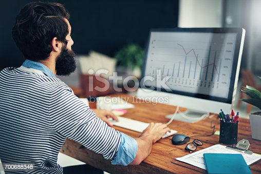 872006502 istock photo Interpreting data is what he does best 700688348