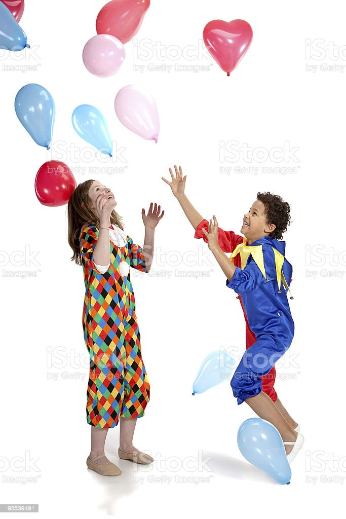 interracial  children in clown costums playind together royalty-free stock photo