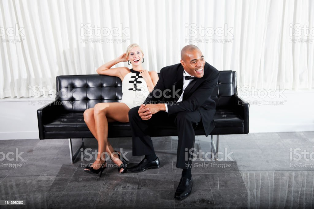 Interracial couple in formalwear laughing royalty-free stock photo