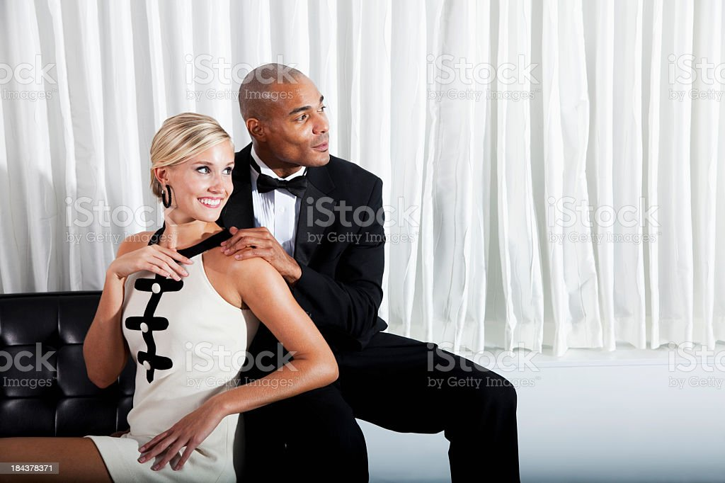 Interracial couple in formalwear stock photo