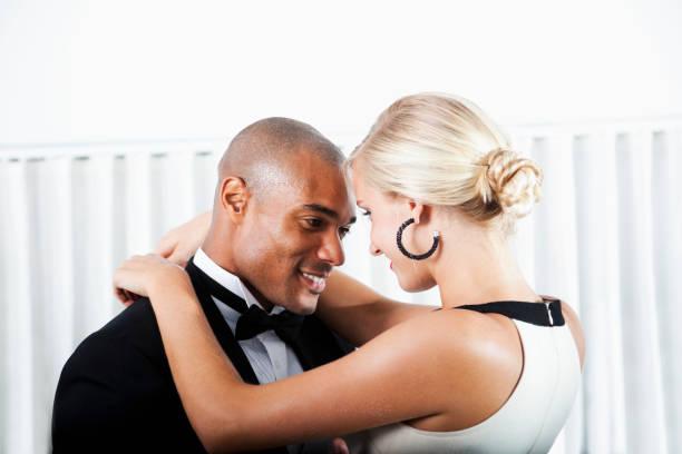 Interracial couple in formalwear stock photo