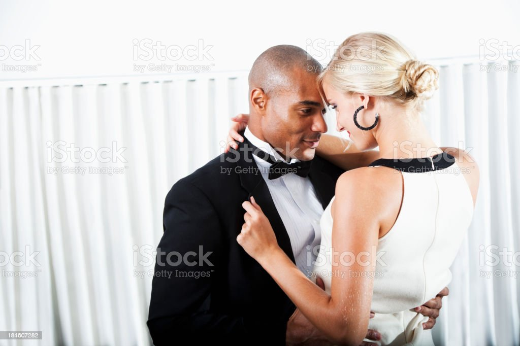 Interracial couple in formalwear royalty-free stock photo