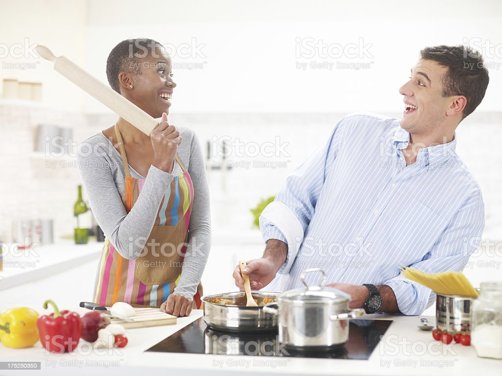 Interracial Couple In The Kitchen royalty-free stock photo