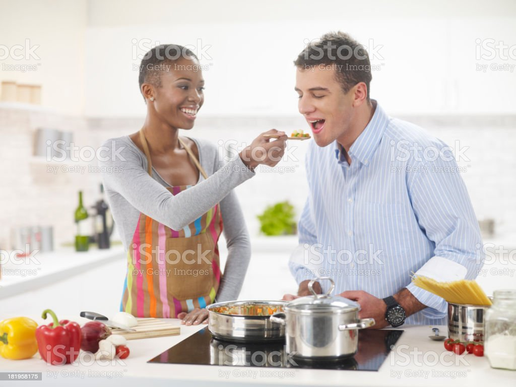 Interracial Couple In The Kitchen stock photo