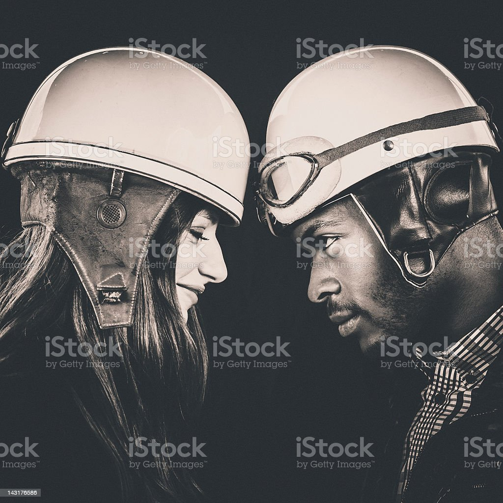 interracial couple looking at each other stock photo
