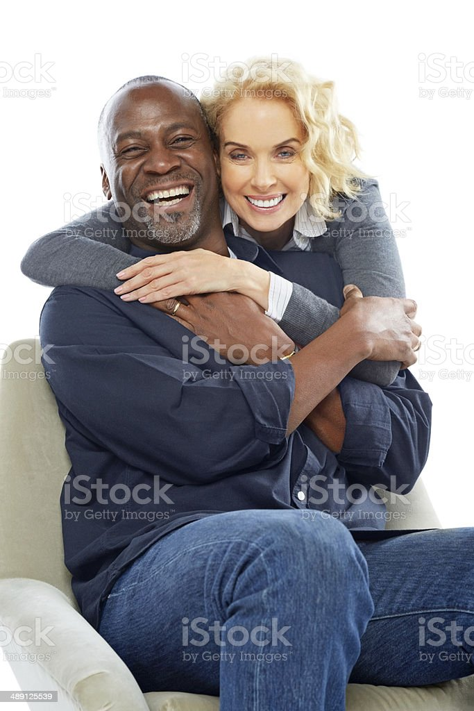 Interracial couple looking happy together stock photo