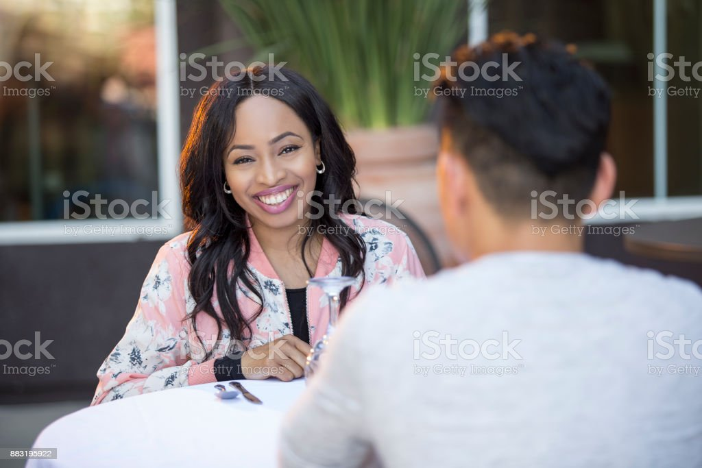 Interracial Couple on a Blind Date or Speed Dating stock photo