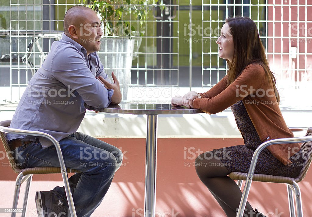 Interracial Couple on a First Date Outdoors stock photo
