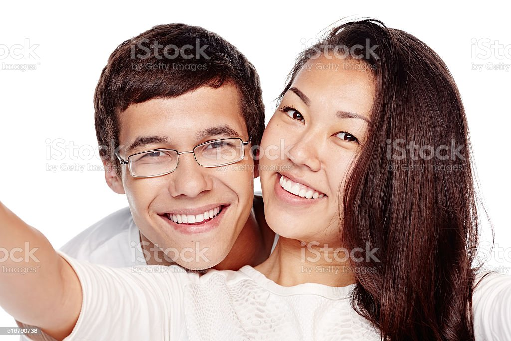 Interracial couple selfie stock photo