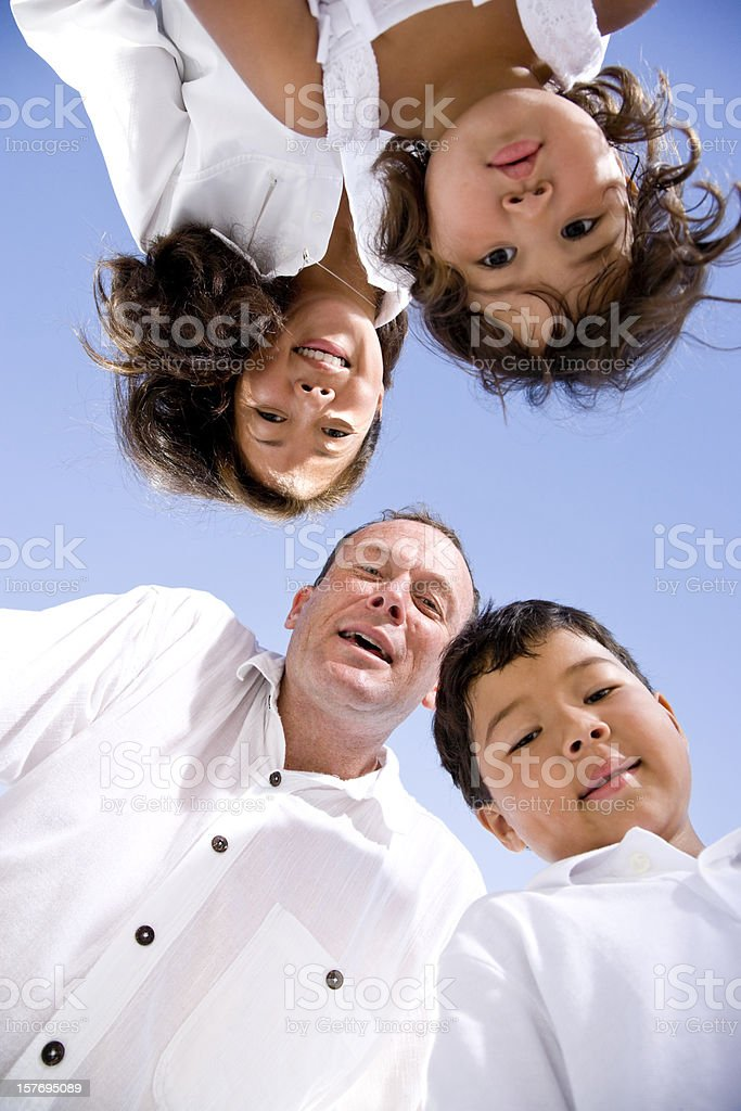 Interracial family faces looking down at camera royalty-free stock photo