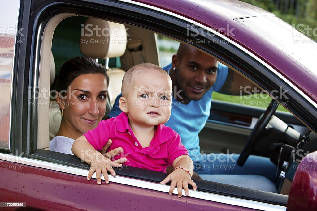 Interracial Family With One Year Old Child In A Car Stock Photo ...