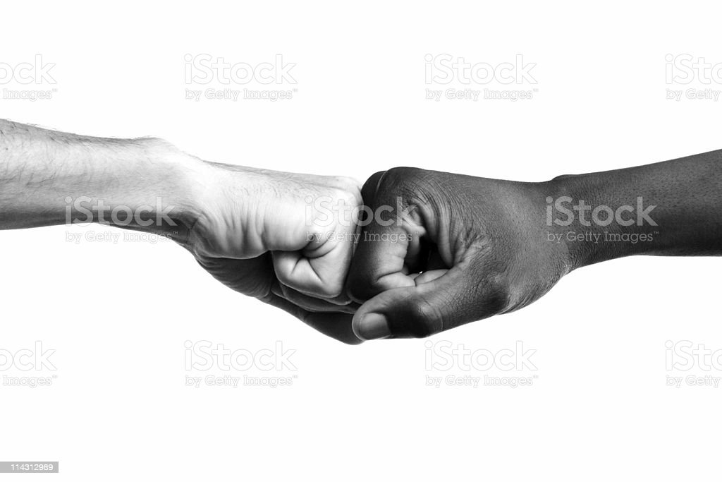 Interracial fists collide  Affirmative Action Stock Photo
