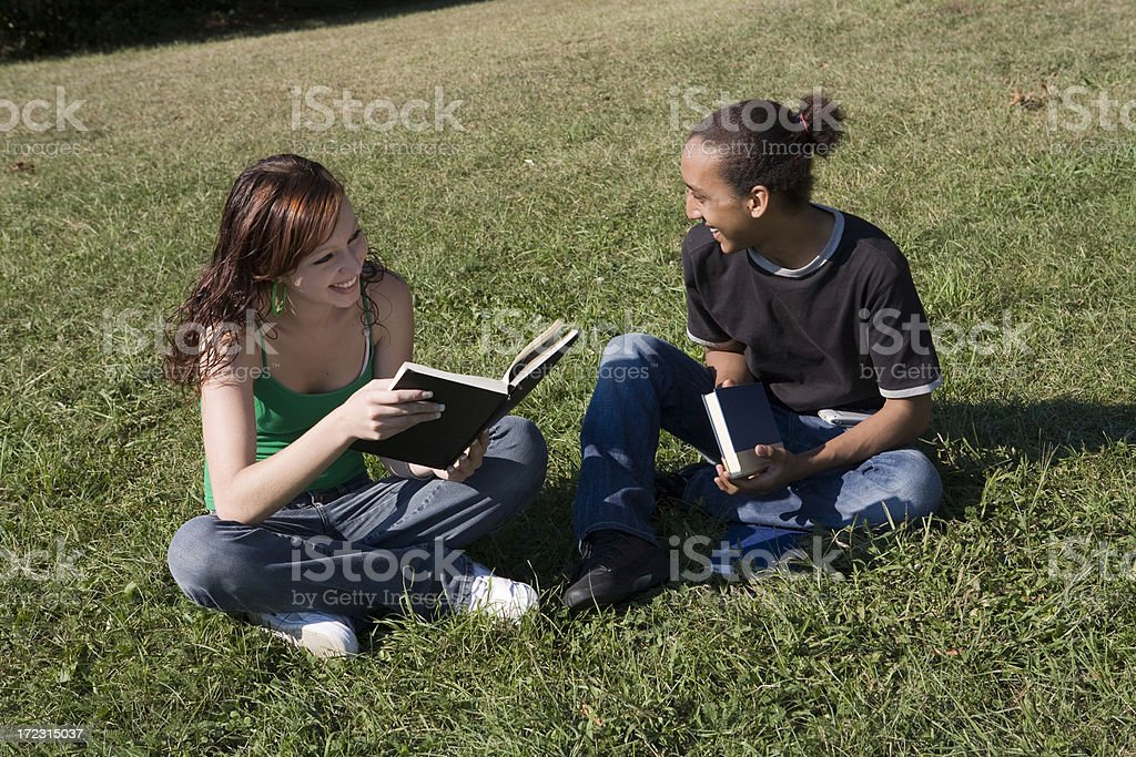 Interracial friends sitting and talking stock photo