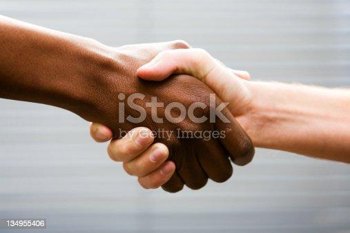 istock Interracial handshake 134955406