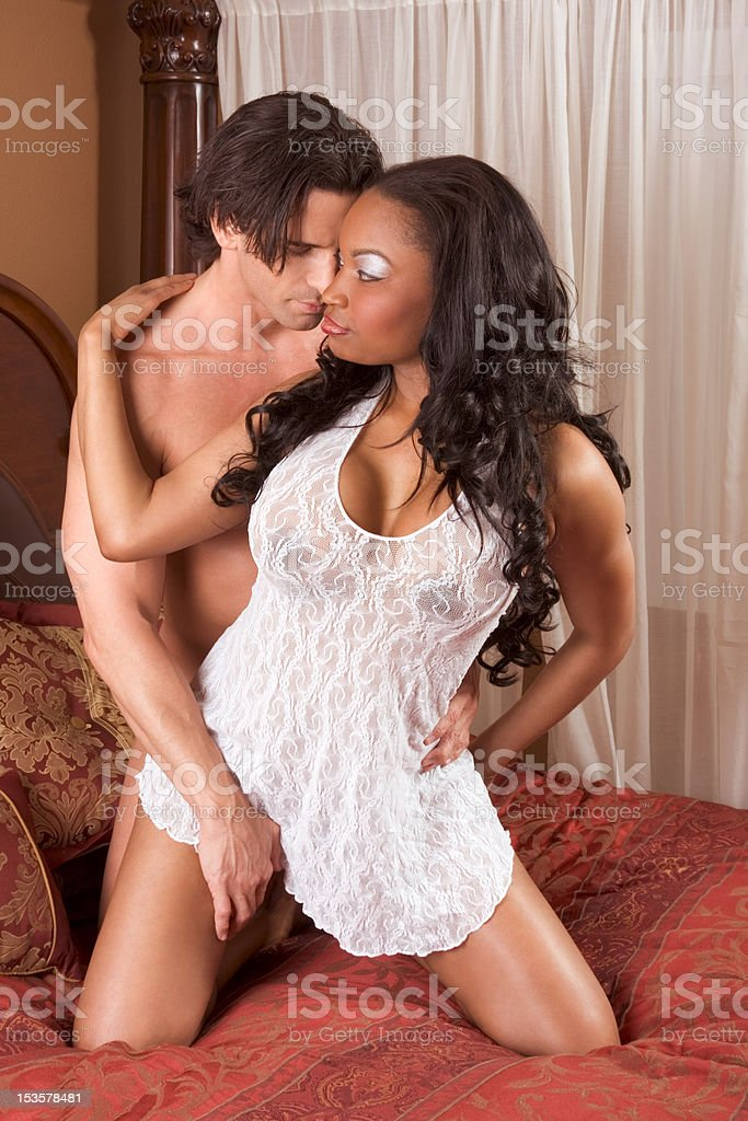 Interracial heterosexual sensual couple in love royalty-free stock photo