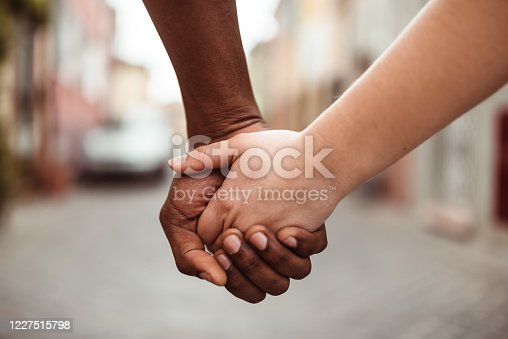 interracial holding hands