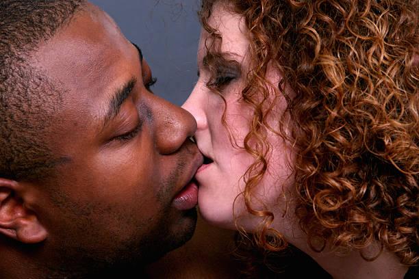 Interracial kiss. stock photo