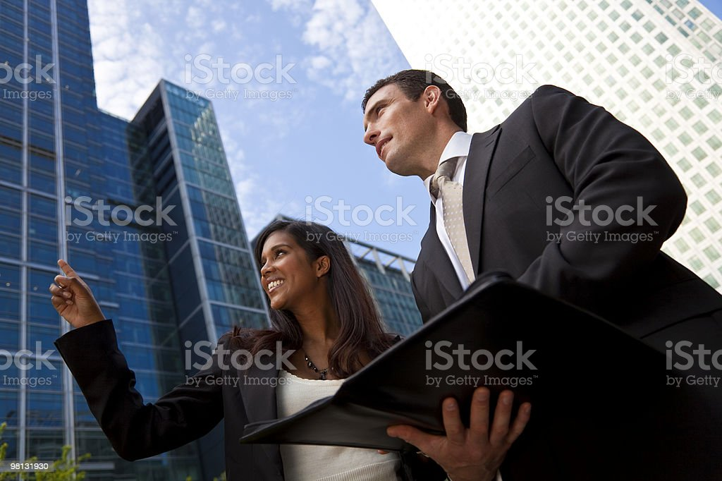 Interracial Male and Female Business Team In Modern City royalty-free stock photo