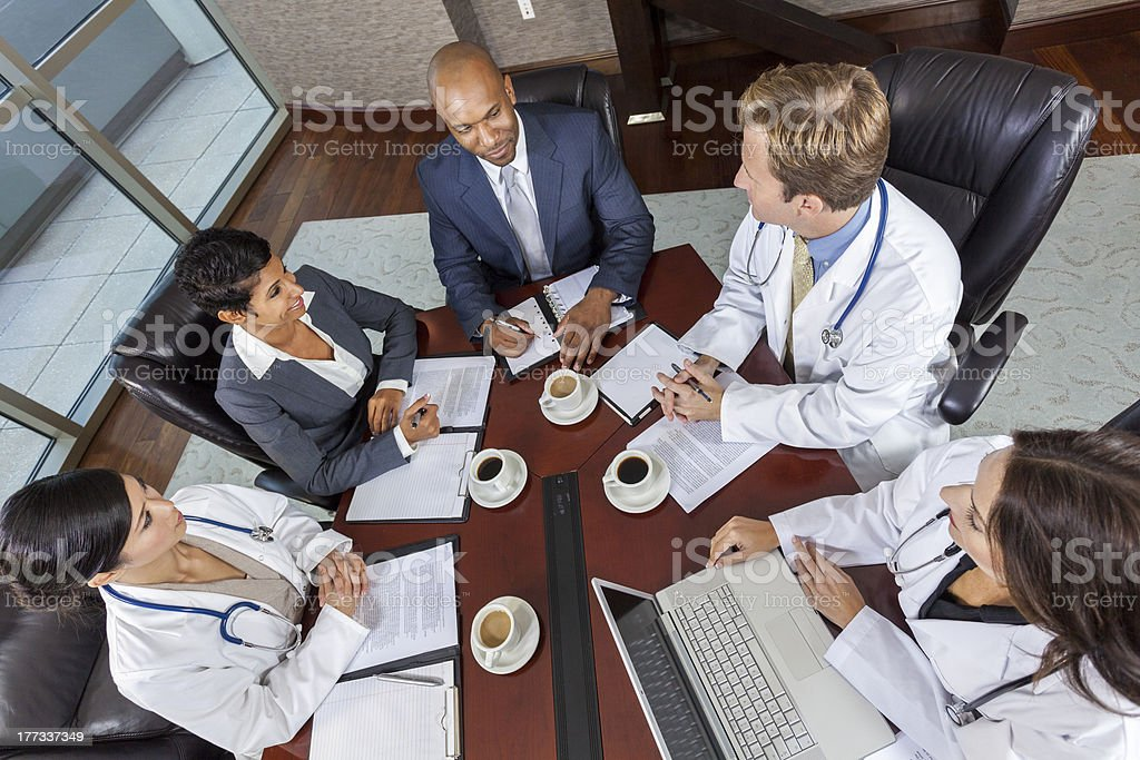Interracial Medical Business Team Meeting in Boardroom royalty-free stock photo