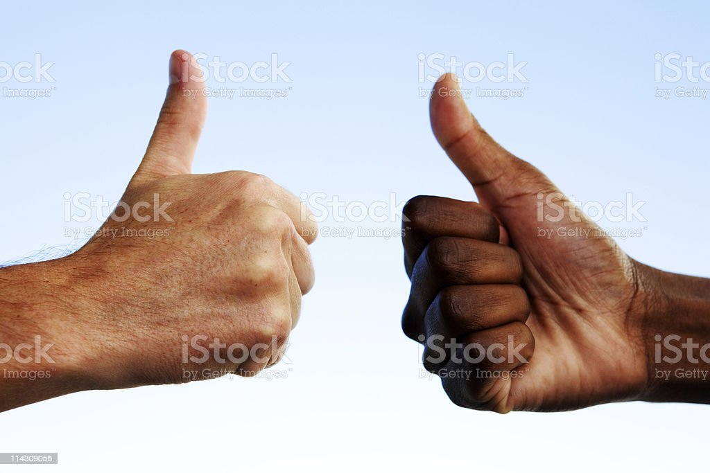 Interracial thumbs-up royalty-free stock photo