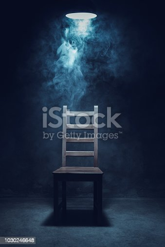 Chair in empty interrogation room