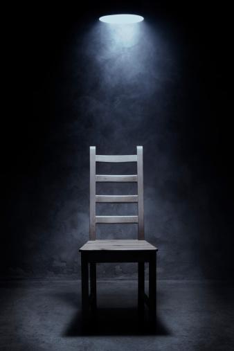 Empty chair in interrogation room