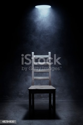 Empty chair in interrogation room