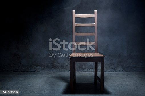 Wooden chair in interrogation room