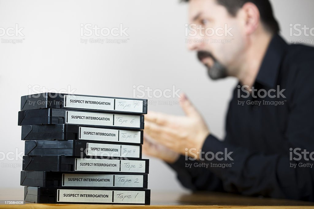 Interrogation tapes and suspect in custody royalty-free stock photo