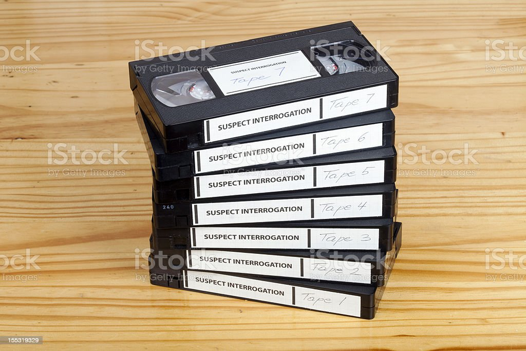 Interrogation tapes on table royalty-free stock photo