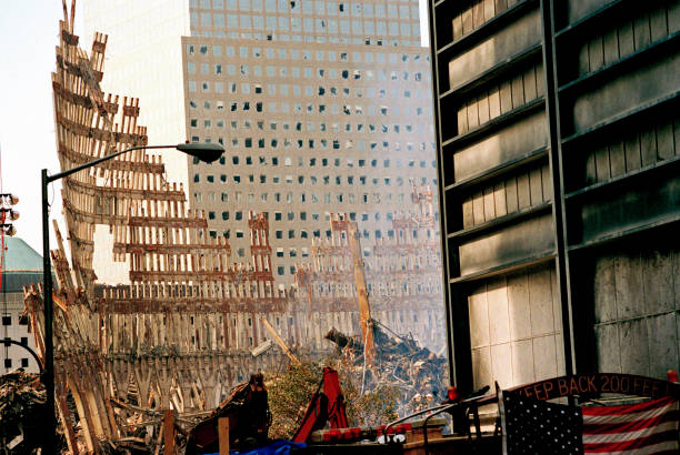 Interrupted image of line of orange paint from squeeze tube Steel Skeleton of World Trade Center Tower South (one) in Ground Zero days after September 11, 2001 terrorist attack which collapsed the 110 story twin towers in New York City, NY, USA. terrorism stock pictures, royalty-free photos & images