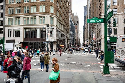 Tourists are walking on Intersection of Fifth ave and West 41, Manhattan downtown in New York City, USA.