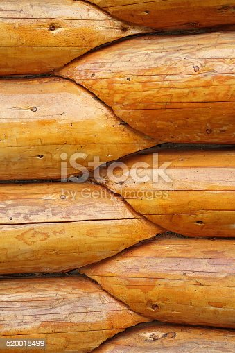 1124475954 istock photo intersection of round wood beams 520018499