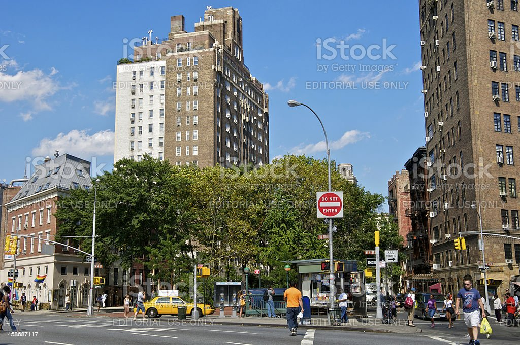 NYC Intersections, 7th Ave & W.4th St, pedestrians crossing stock photo