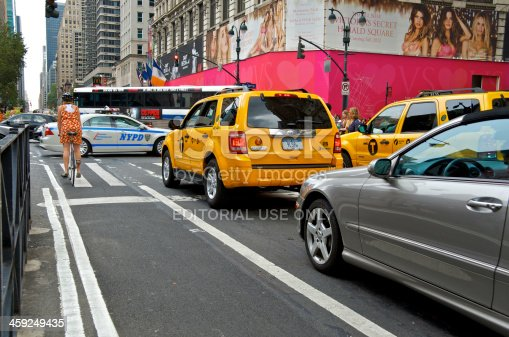 583973114istockphoto NYC Intersections, Bicyclist at 34th St & 6th Ave, Manhattan 459249435