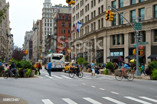 583973114istockphoto NYC Intersections, Bicyclist at Broadway & 5th Ave, Manhattan 458923487