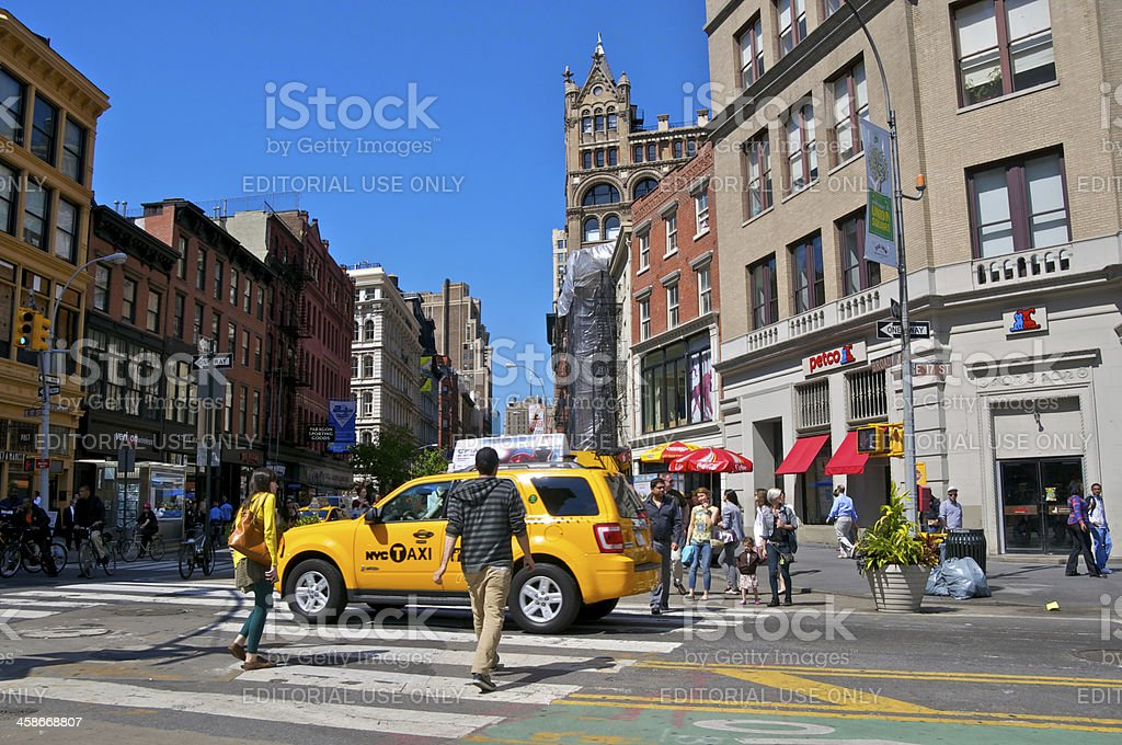 NYC Intersections, Bicyclists & pedestrians cross E.17th St, Manhattan stock photo