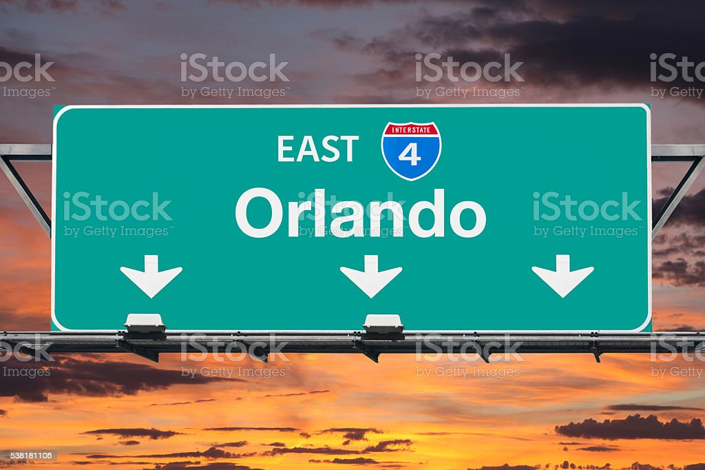 Interstate 4 East to Orlando Highway Sign with Sunrise Sky stock photo